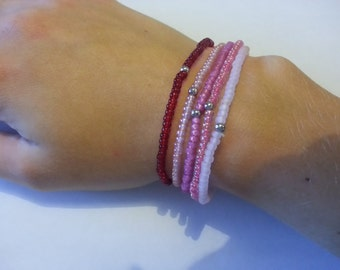 Stackable bracelets in pink colours