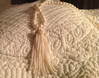 Pearl necklace featuring a pearl tassel
