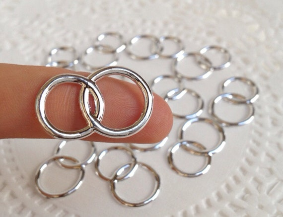 48 plastic joined silver tone wedding rings for cupcake