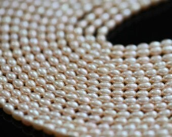 AAA Natural Champagne Peach Center-drilled Rice Freshwater Pearls, 7 - 8 mm, 10 beads (FP0201RC)