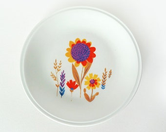White ceramic plate with colored flowers