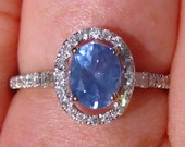 Precision Cut Blue Spinel and Diamond Halo Engagement Ring