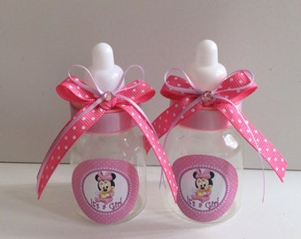 minnie mouse baby shower favors in pink and purple minnie mouse baby