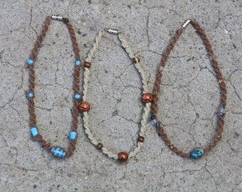Twisted jute jewelry.  Necklaces, anklets and bracelets  Each with different colors and shapes of beads and jute