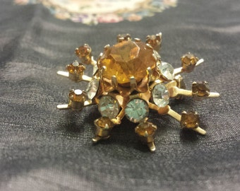 Vintage Starburst Pin set in Gold with Orange and Clear Rhinestones