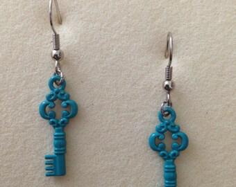 Teal colored key earrings