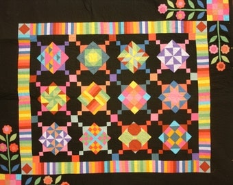 Colorful Amish-type queen quilt with applique