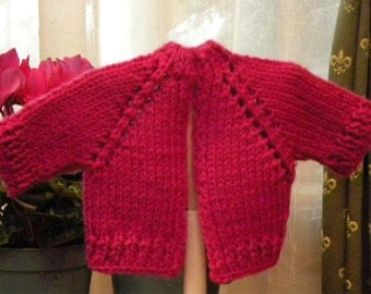 Hand knitted cardigan for dolls