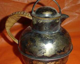 Antique Pitcher with wicker handle , has a Hallmark