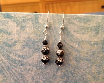 Black crystals adorned with Bali Silver bead caps.