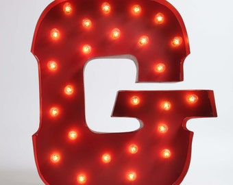 Awesome Whimsical lighted carousel letter G.  includes lights, a teeny assembly process.  safe for outdoor or indoor use!