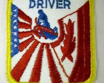 Snomobile DRIVER Crest with USA & Canadian flags jacket or shirt patch.