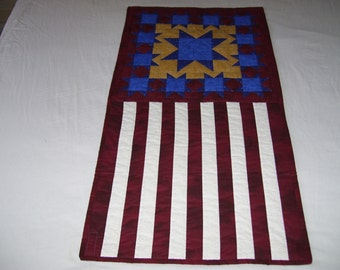 Patriotic quilt for a wall or door for anyone who is Patriotic and cares for their country. It is machine quilted and pieced.