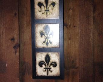 Handpainted fleur de lis on ceramic tiles mounted on wood back