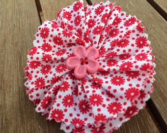 Red & white floral fabric flower brooch with a pink contrasting button. Pin it to a jacket, top, dress or your favourite handbag.