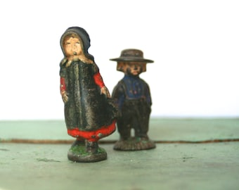 1940s Cast Iron Miniature Amish Woman and Farmer Figurines