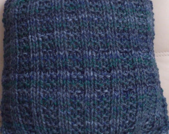 Blue-green knitted cushion of mixed wool