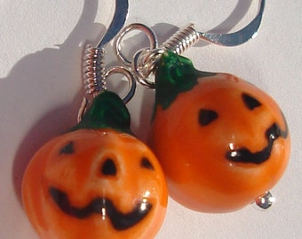 petite ceramic orange pumpkin jack-o-lanterns from Peru pierced dangle hand made wire wrapped earrings