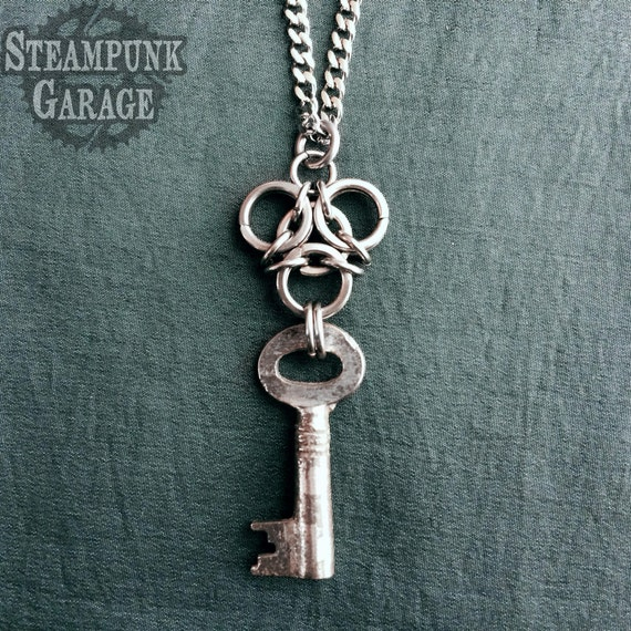 Biohazard Aura Pendant with Antique Key