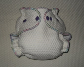 Zorb 2 Fitted diaper with punch thread and purple snaps