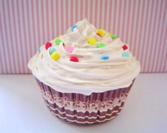 Vanilla topped faux cupcake sprinkled with candy's fake cupcake for party decoration.