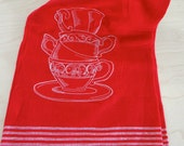 A Fancy Teacup Stack Embroidered on a Red Towel By InYourBones