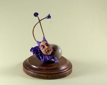 Viola Seta. Sleeping fairy snail. Polymer clay miniature by Madre Olius