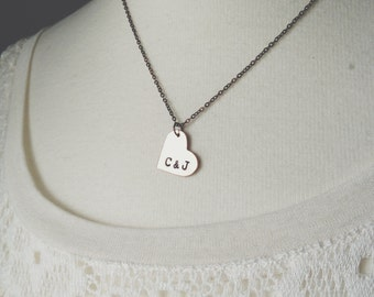 custom hand stamped initial necklace.