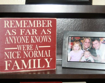 Remember as far as any knows we're a nice normal FAMILY - wood sign home decor with vinyl lettering