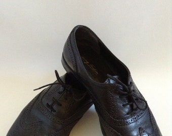 Black leather oxfords