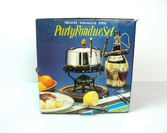 vintage new deluxe stainless steel party fondue set, new in wrappers in original box, color skewers, pan, wood stand, free u.s. shipping