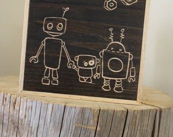 6x6 Woodblock canvas: A family of robots.