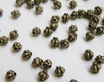 20 Lantern or melon shaped spacer beads antique bronze 6mm DB31953