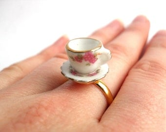 Ceramic tea cup ring with pink flower pattern