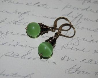 Wire Wrap Style Green Cat Eye Glass Earrings.
