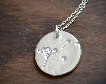 delicate silver necklace with a small dandelion round charm  ///  simple everyday jewelry