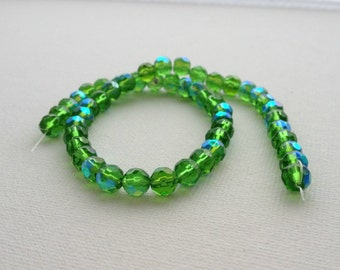 6mm Electroplate Green Faceted Round Glass Beads