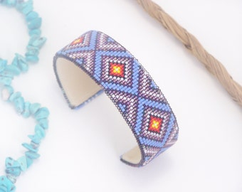 Native American Beaded Cuff Bracelet In Shades of Purples, and With The Fire Colors Of The Southwest by LJ Greywolf