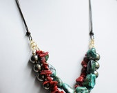 Turquoise, red coral, and pyrite necklace on leather