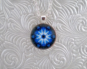 Blue, white and black abstract kaleidoscope pendant necklace