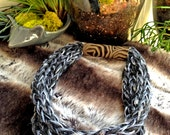 Hand knitted grey wool necklace with an embossed leather cuff