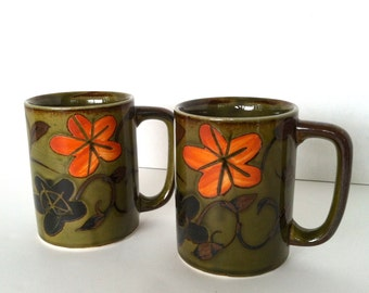 Pair Vintage Stoneware Mugs Dark Green Brown and Orange Flowers