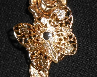 Gorgeous golden rose and filigree butterfly pin.