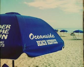 Printable Beach Photo   Beach Photography Digital Download   Blue Beach Umbrella by the Sea   Printable Beach Wall Art   Digital Print