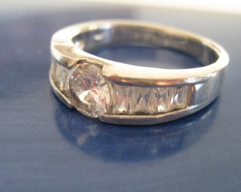 Vintage silver ring with CZ and baguette cut stones.  Size 8.