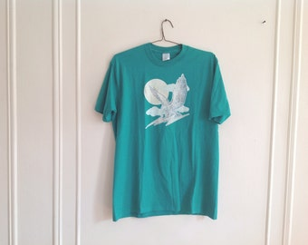 70's Turquoise eagle, lightning, clouds design T-Shirt - size large