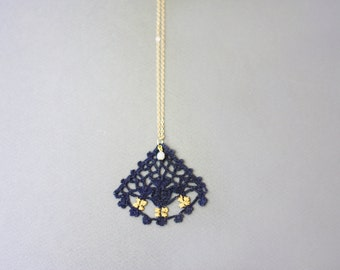 Pendant necklace in blue crochet lace with gold hand painted details