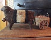 Brown Wool Sheep Pulling Primitive Wagon