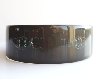 Black lucite bracelet with two exotic real insects
