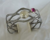 Industrial Bangle - Found iron fencing material, silver, topaz and ruby